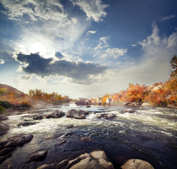 Rapid mountain river among stones