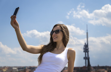 Portrait of a beautiful young tourist woman
