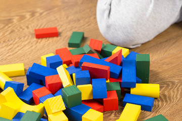 child is playing with multicolored cubes