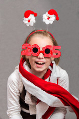 Happy little Christmas child girl with glasses 2015