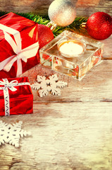 Christmas background with gifts, candle and balls