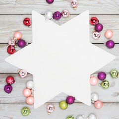 background - white star with colorful frame of christmas balls