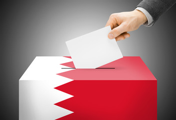 Ballot box painted into national flag colors - Bahrain