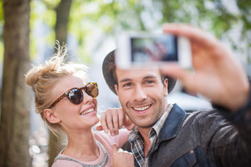 Young trendy couple in the city making a Selfie with a smartphon