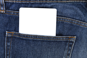 Part of white card paper in the front pocket of blue denim jeans