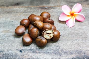 Chestnut on wood background.