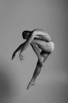 Dance freedom concept. Young handsome ballet man in fly grace po