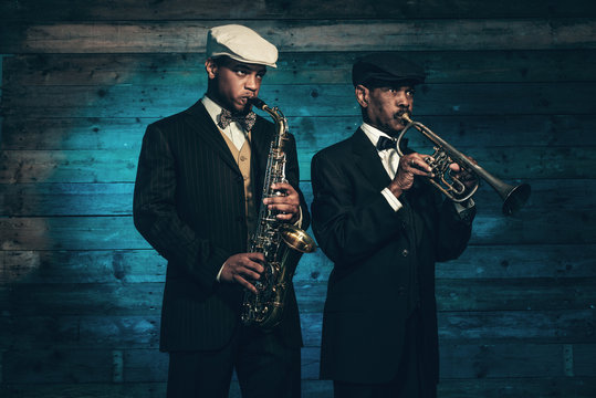 Two vintage african american jazz musicians with trumpet and sax