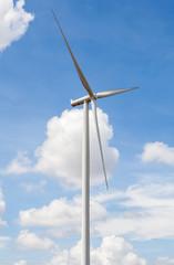 Closeup of wind turbine producing alternative energy in wind far
