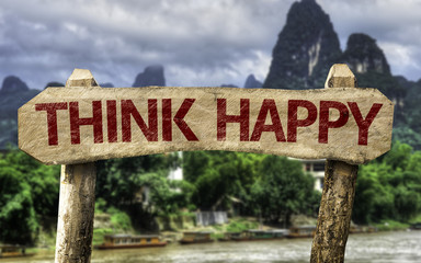 Think Happy sign with a forest background
