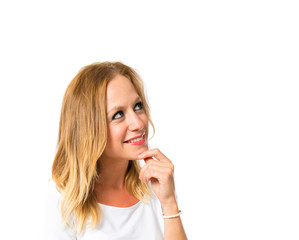 Woman thinking over isolated white background