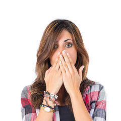 Girl doing surprise gesture over white background