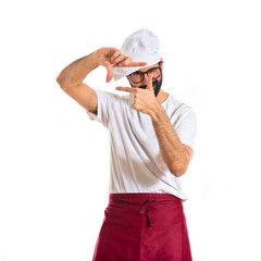 Chef focusing with his fingers