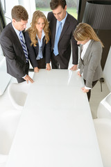 Group of businesspeople leaning on a table