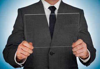 Businessman holding a transpaent glass screen