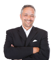 Smiling Mature Businessman Standing Arms Crossed