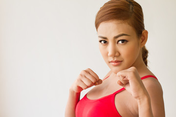 strong woman on her guard : concept of martial arts, boxing