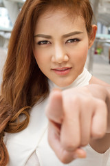 confident woman pointing finger at you