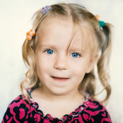Cute little girl over bright background. Color toned image.