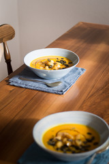 Pumpkin soup with caramelized apples, seeds and balsamic vinegar