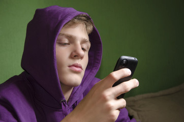 Sad depressed kid waiting for text message reply