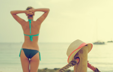 Straw hat against sea background.