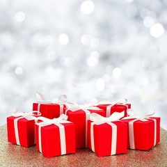 Group of red and white gift boxes over a twinkling background