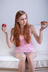 Girl disusted by doughnut