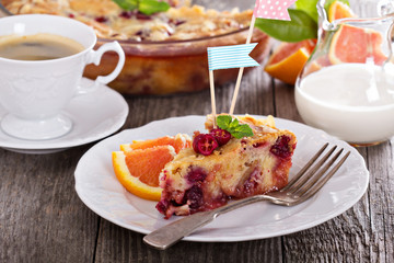 Tasty cake with orange, apple and cranberries