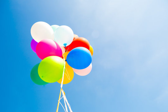 Bunch of colorful balloons in  sky