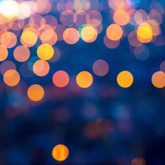 merry christmas lights abstract circular bokeh on blue backgroun