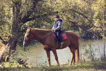 horse ride young guy autumn forest
