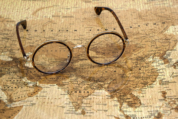 Foto op Plexiglas Wereldkaart Glasses on a map of a world - Russia
