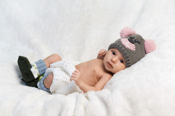 newborn baby in knitted cap