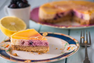 traditional lemon cheese cake and blueberry on table