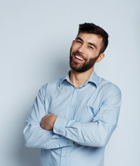 A young bearded man smiling