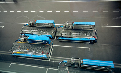 luggage carrying vehicles in modern airport