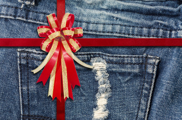 Red Ribbon on  detailed scan of jeans for background