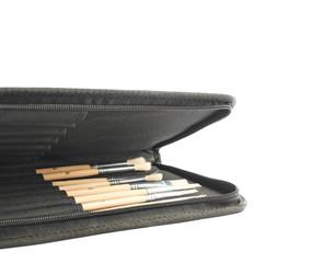 Opened black case for brushes isolated