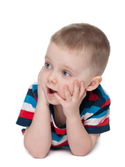 Surprised little boy on the white background