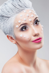 Fashion woman with professional rhinestone make up. Studio