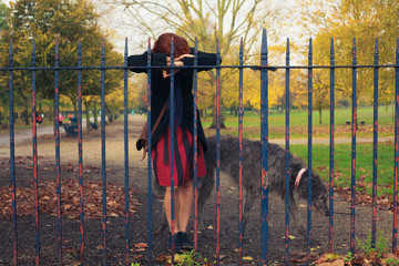Sad woman with dog in park
