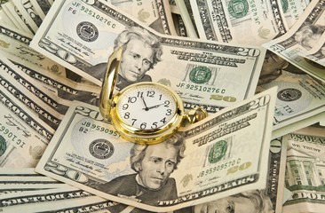 clock and heap of dollars