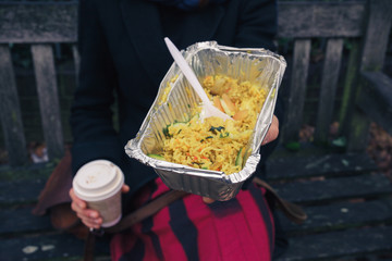 Woman on bench with indian food