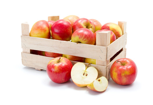 Ripe apples in wooden carte