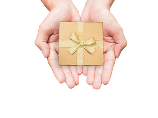 Hand holding golden gift box isolated