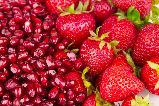 Pomegranate and strawberries.