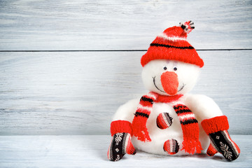 Christmas snowman on a light wooden background