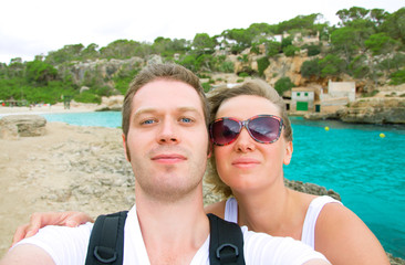 Selfie. Couple taking picture on the beach.