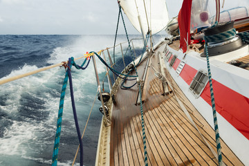 Fototapete - sail boat navigating on the waves